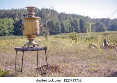 Vintage metal copper tea samovar. Samovar side view. Retro soot grunge tea samovar was used for a long time. Burned with firewood