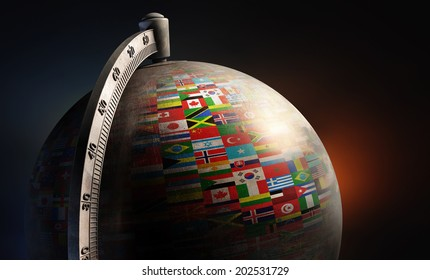 vintage metal desktop globe with nation flags on dark abstract background