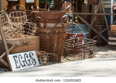 Vintage metal egg baskets sit on sale at Georgia antique festival.