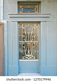vintage metal and glass blue white door  on blue wall, Athens Greece