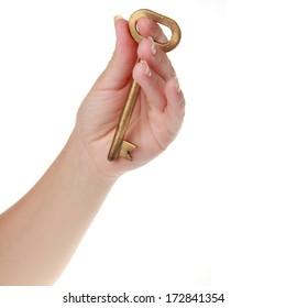 Vintage metal key in a female hand