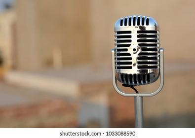 Vintage metal microphone closeup view outdoor