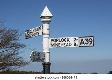 vintage metal road direction sign on top of Porlock Hill, with a very steep 1 in 4 gradiant