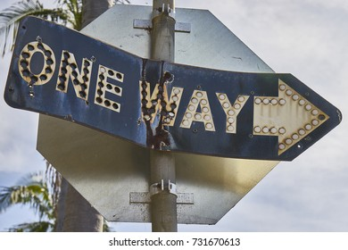 vintage metal street sign made out of two metal pieces rivitted together