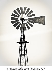 Vintage metal windmill against white background