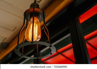 Vintage metallic lamp design with the roof of cafe background