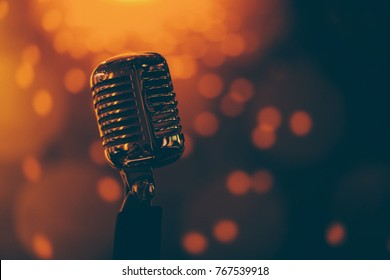 vintage microphone with color background in nightclub