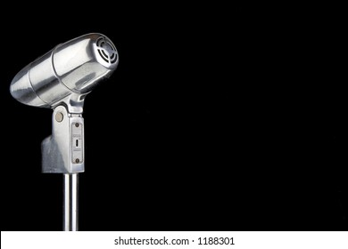 Vintage microphone over black with room for text