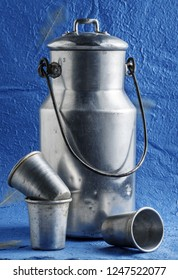 vintage milk churn on blue background