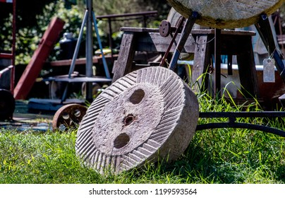 vintage milling stone or grinding stone at a salvage yard