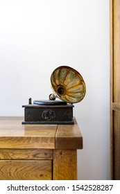 Vintage mini gramophone on a wooden cupboard
