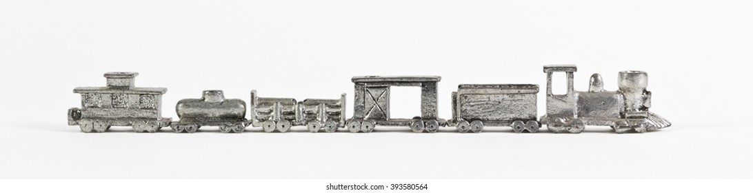 Vintage Miniature Pewter Train Steam Engine Locomotive and Cars on White Background