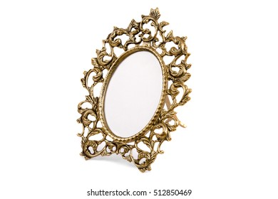 Vintage mirror in a gold frame on white background
