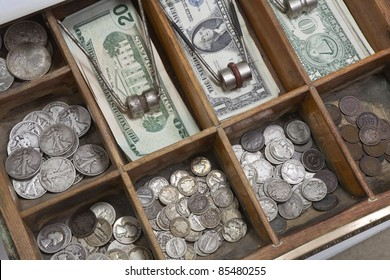 Vintage money drawer with old US coins from the 1930's.