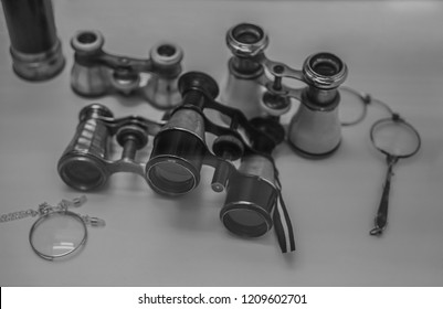 vintage monocle, pince-nez, binoculars and retro spyglass