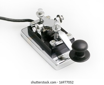 vintage morse telegraph key with white background