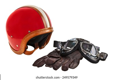 Vintage motor helmet with goggles and gloves isolated on a white background