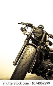 vintage Motorcycle detail on the road,vintage tone
