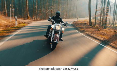 Vintage Motorcycle Driving on country road