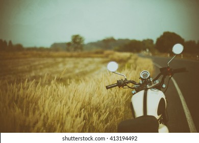 Vintage motorcycle on beautiful route in grunge style