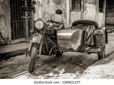 vintage motorcycle with sidecar in street of old Havana,Cuba