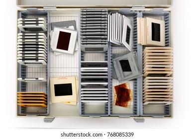 Vintage mounted film slides in slide boxes filled with memories