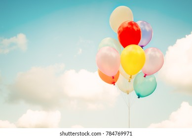 Vintage multicolor balloons with done with a retro instagram filter effect on blue sky. Ideas for the background of love in summer and valentine, wedding honeymoon concept.