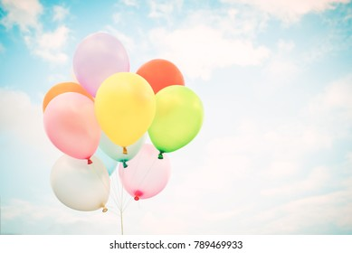 Vintage multicolor balloons with done with a retro effect on blue sky. Ideas for the background of love in summer and valentine, wedding honeymoon concept.