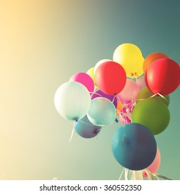 Vintage multicolored balloons of birthday party. Instagram retro filter effect
