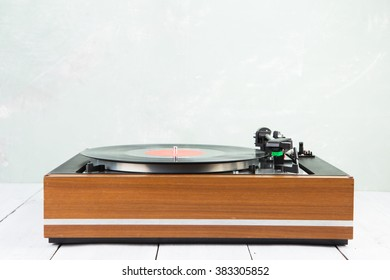 vintage music player turntable with lp record