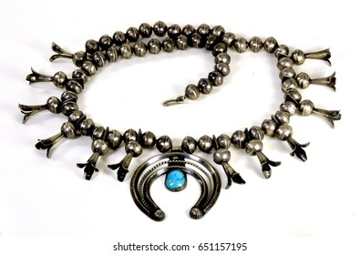 A vintage native American squash blossom necklace with turquoise on silver