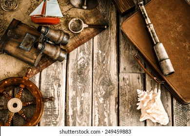 Vintage nautical things on wood background. Grunge retro toned image with copy space. Travel and adventure concept. Top view
