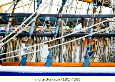 Vintage Nautical Wooden Sailing Ship, close-up view on the tackles and cordage ropes