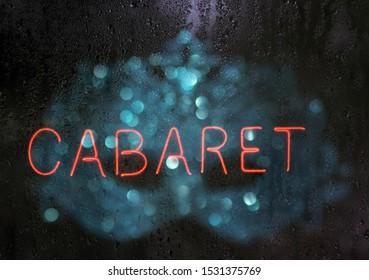 Vintage Neon Cabaret Sign With Bokeh Carnival Mask
