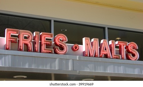 vintage neon fries and malt sign