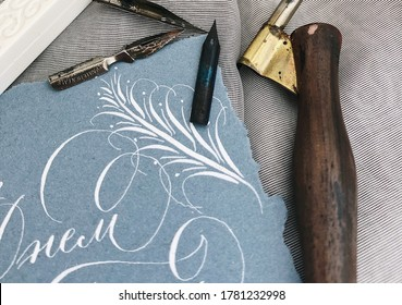 Vintage nibs. Post card decorated with florals. Wooden nib holder. Classic calligraphy. Copperplate.