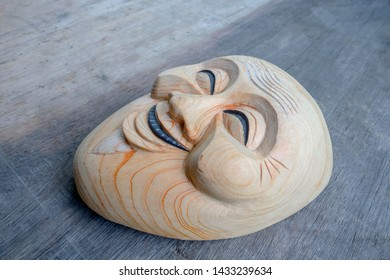 Vintage noh mask made of wood on  wood table
