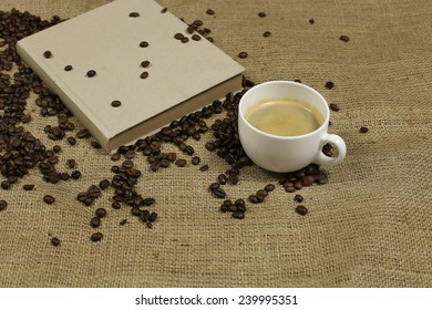 Vintage notebook with coffee mug, coffee cream and coffee beans