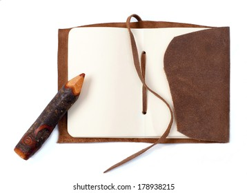 vintage notebook and pencil on white background
