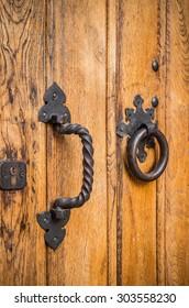 Vintage oak wood door with iron elements