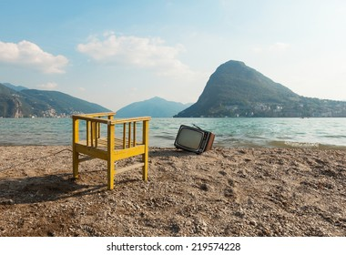 vintage objects on the lake shore, chair and television