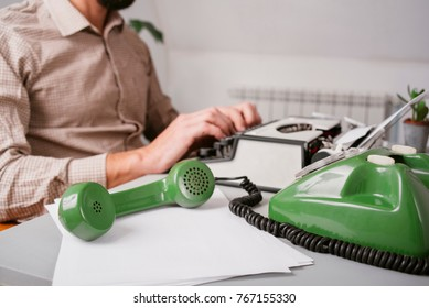 Vintage office with typewriter and green telephone