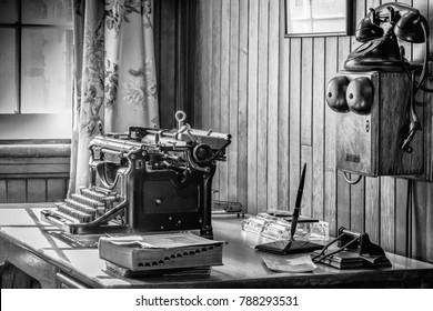 Vintage office with typewriter and telephone.