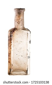 Vintage oil and tincture glass bottle weathered on white background. Old bottle with calcium deposits