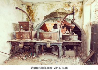 Vintage old abandoned winery, old equipment and grape presses. Sardinia Italy