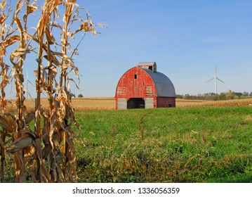 Vintage old barn in Central Ill., the middle of corn & soybean country.  I love the juxtaposition of the old vintage barn and the new electricity-producing wind turbines in the background.