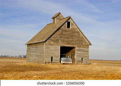 Vintage old barn or corn crib in Central Ill.  This one has an old blue pickup truck parked inside.  You can almost feel history oozing out of these old structures.