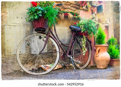 Vintage old bike - charming street decoration.Artwork in retro style