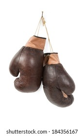 Vintage old boxing gloves hanging with lace on nail isolated over white background.