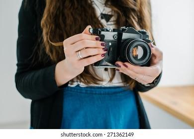 vintage old camera in hand
